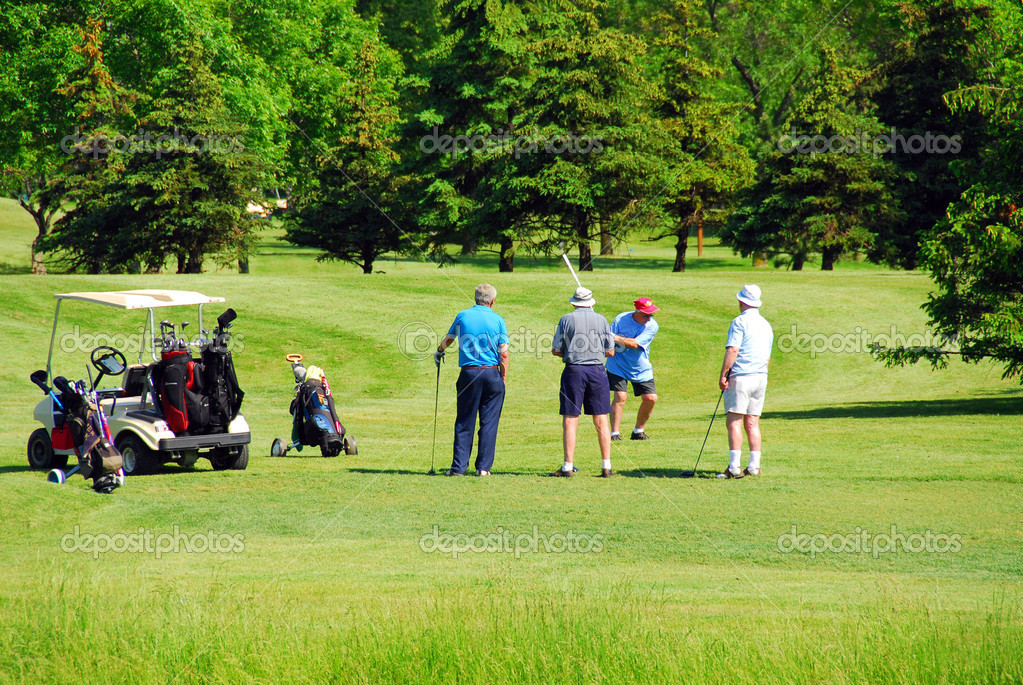 Active senior men on golf course — Stock Photo #6980499
