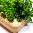Fresh parsley on cutting board 1 — Stock Photo
