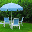 Patio furniture on lawn - Zdjęcie stockowe
