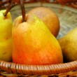 Pears in a basket - Stock Photo
