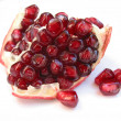 Pomegranate seeds on white — Stock Photo #7085104