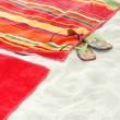 Beach towels on sand — Stock Photo