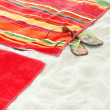 Beach towels on sand - Stock Photo