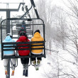 Skiers on chairlift — Stock Photo #7085255