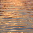 Water surface gold - Stock Photo
