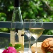 Royalty-Free Stock Photo: White wine with glasses outside