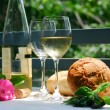 Stock Photo: White wine with glasses outside
