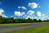 Road and blue sky — Stock Photo