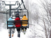 Skiers on chairlift — Stock Photo