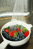 Washing berries — Stock Photo