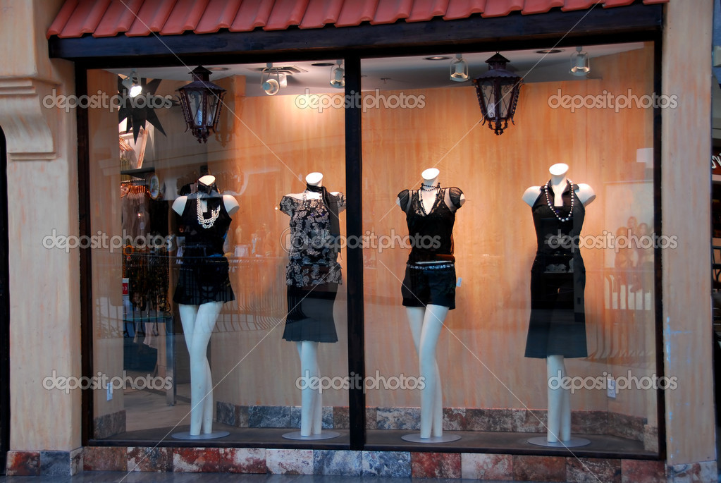 Boutique window with dressed mannequins — Stock Photo #7085242