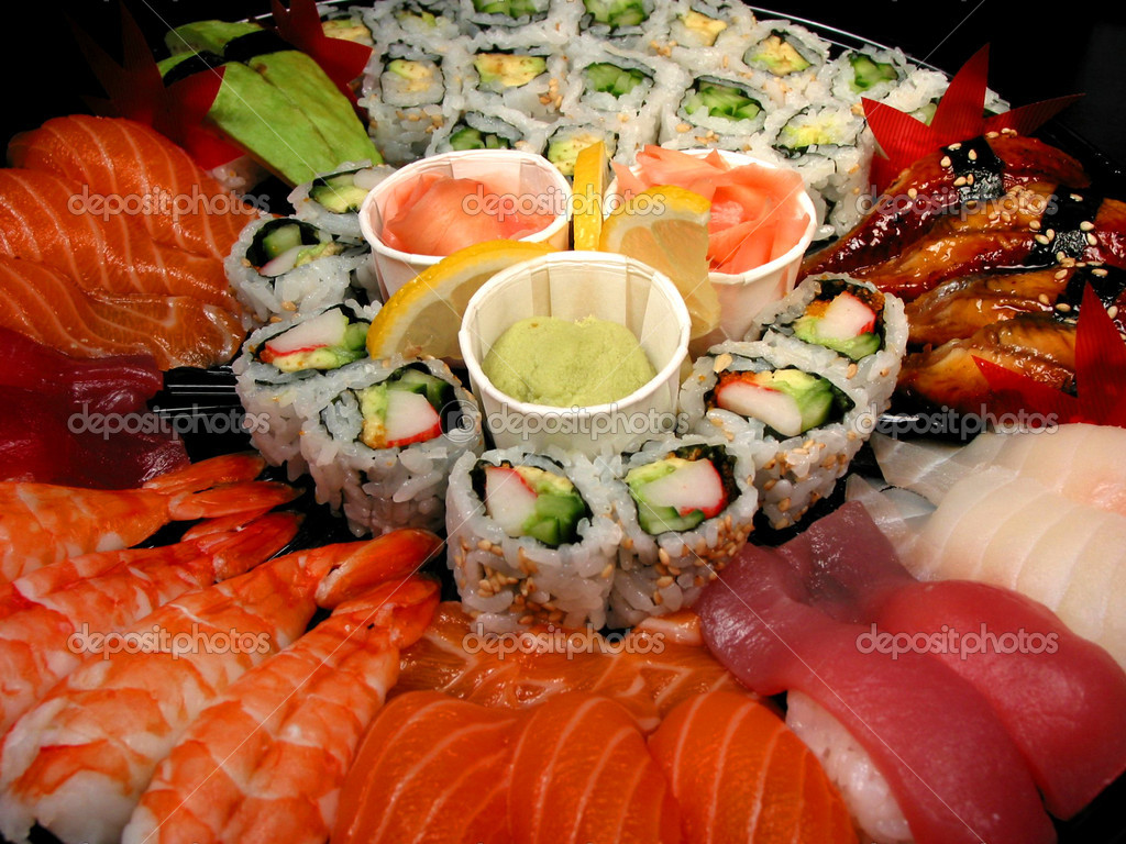 Party tray of sushi and rolls, closeup  Stock Photo #7085335
