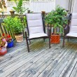Chairs on wooden deck — Stock Photo