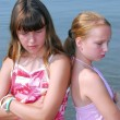 Two girls pouting — Stock Photo #7609898