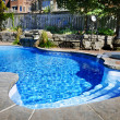 Swimmingpool mit Wasserfall — Stockfoto #7610700