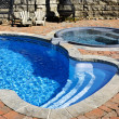 Swimming pool with hot tub — Stock Photo