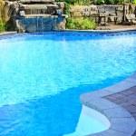 Swimming pool with waterfall — Stock Photo