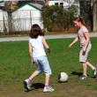 Stock Photo: Girls playing soccer