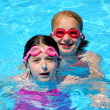 Girls children pool — Stock Photo