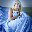 Woman scared in bed — Stock Photo