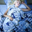 Stock Photo: Womsleeping in bed at night