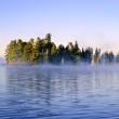 Island in lake with morning fog — Stock Photo