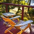 Chair on cottage deck — Stock Photo #7611967