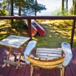 Chair on cottage deck — Stock Photo