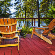 Forest cottage deck and chairs - Stock Photo