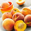 Peaches on plate - Stock Photo
