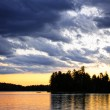 Dramatic sunset at lake - Stock Photo