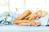 Woman sleeping in bed — Stock Photo