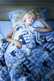 Woman sleeping in bed at night — Stock Photo