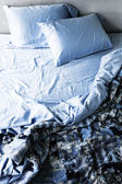 Unmade bed and bedding — Stock Photo