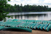Canoes on lake shore — Stock Photo