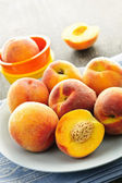 Peaches on plate — Stock Photo
