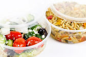 Prepared salads in takeout containers — Stock Photo