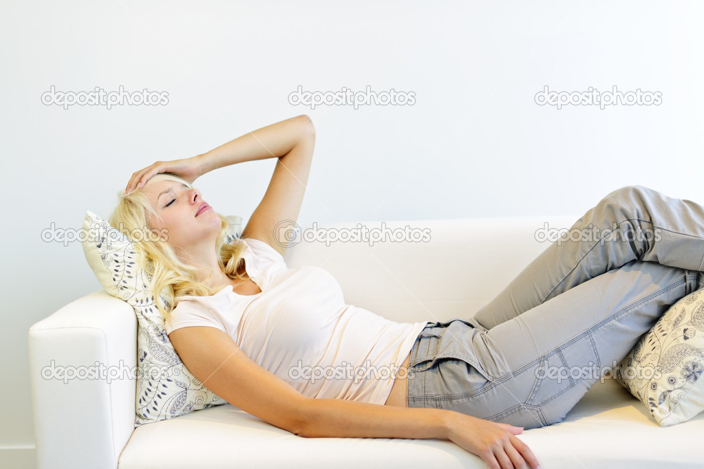 Tired Woman Laying On Couch Stock Image