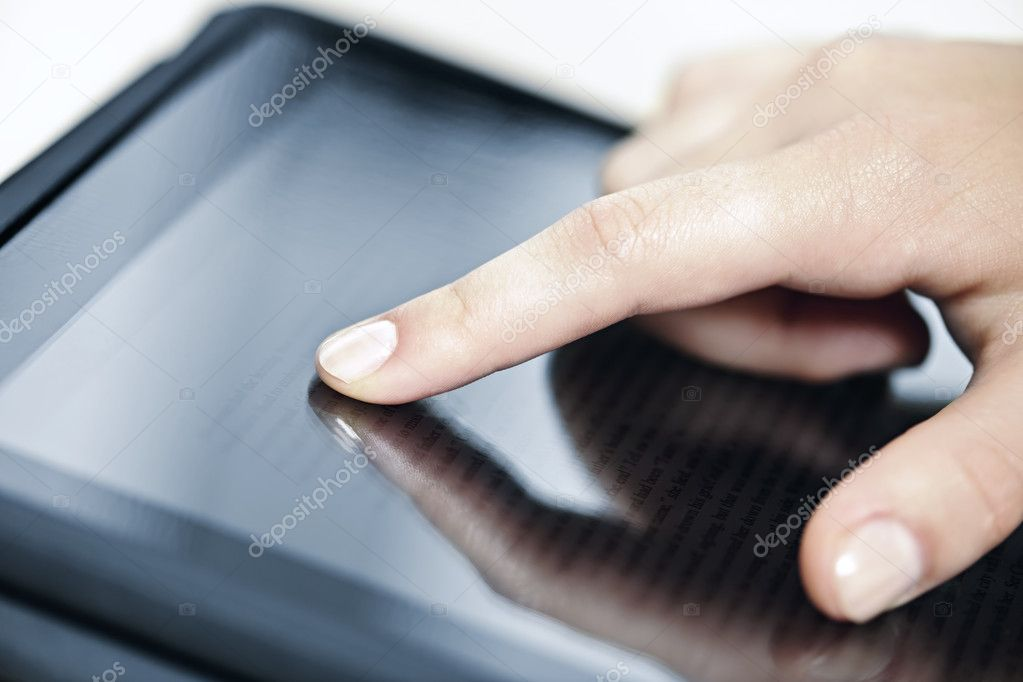 Female hand touching tablet computer screen with finger — Stock Photo #7612124