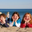 Three children on a beach - Stockfoto