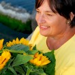 Mature woman flowers — Stock Photo
