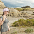 Stock Photo: Hiker in badlands of Alberta, Canada