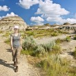 Hiker in badlands of Alberta, Canada — Stock Photo #7638461