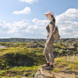 Hiker in badlands of Alberta, Canada - Stock Photo