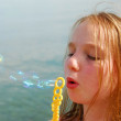 Girl blowing bubbles — Stock Photo #7638469