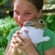 Girl and bunny — Stock Photo