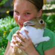 Girl and bunny - Stockfoto