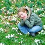 Girl in crocus field — Stock Photo #7638480