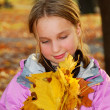 Girl with leaves - Stock Photo