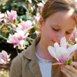 Stock Photo: Girl with magnolia